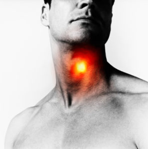 Man with 'heat spot' over throat, close-up (Digital Composite)