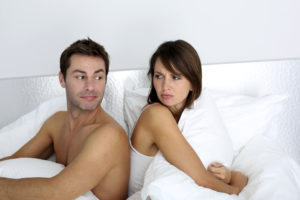 Angry couple in bed